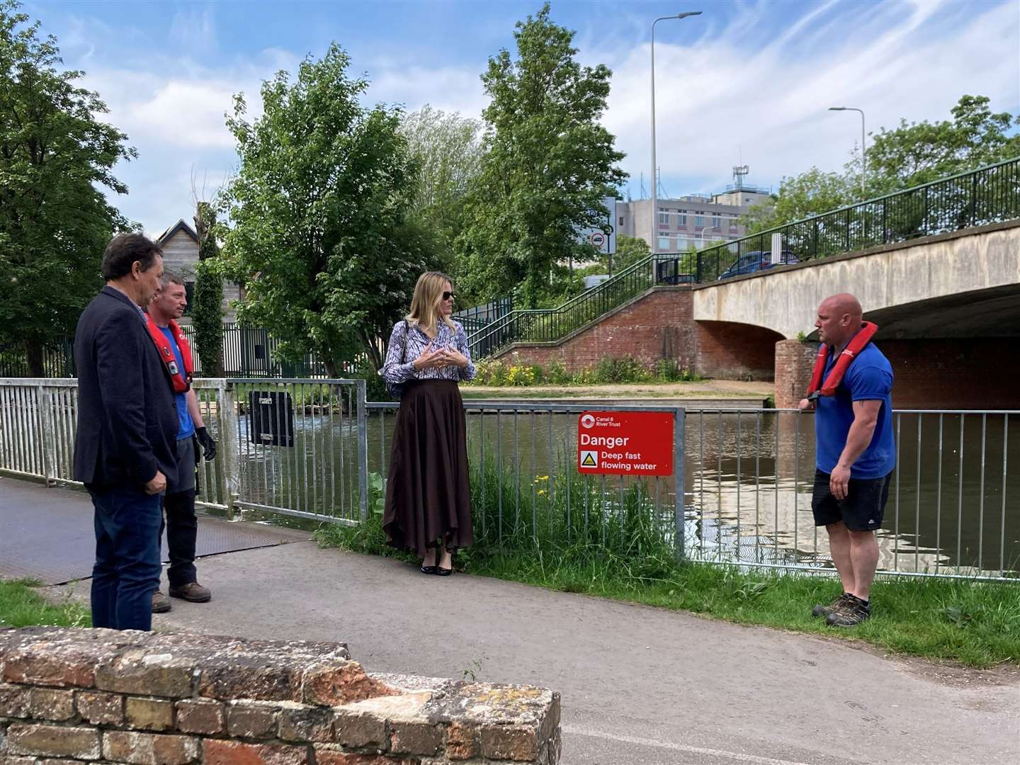 Mark Evans and Shaun Swain of Canal and River Trust, Laura Farris MP and Dean Adlem (Canal & River Trust) inspect new railings in Newbury on June 2.