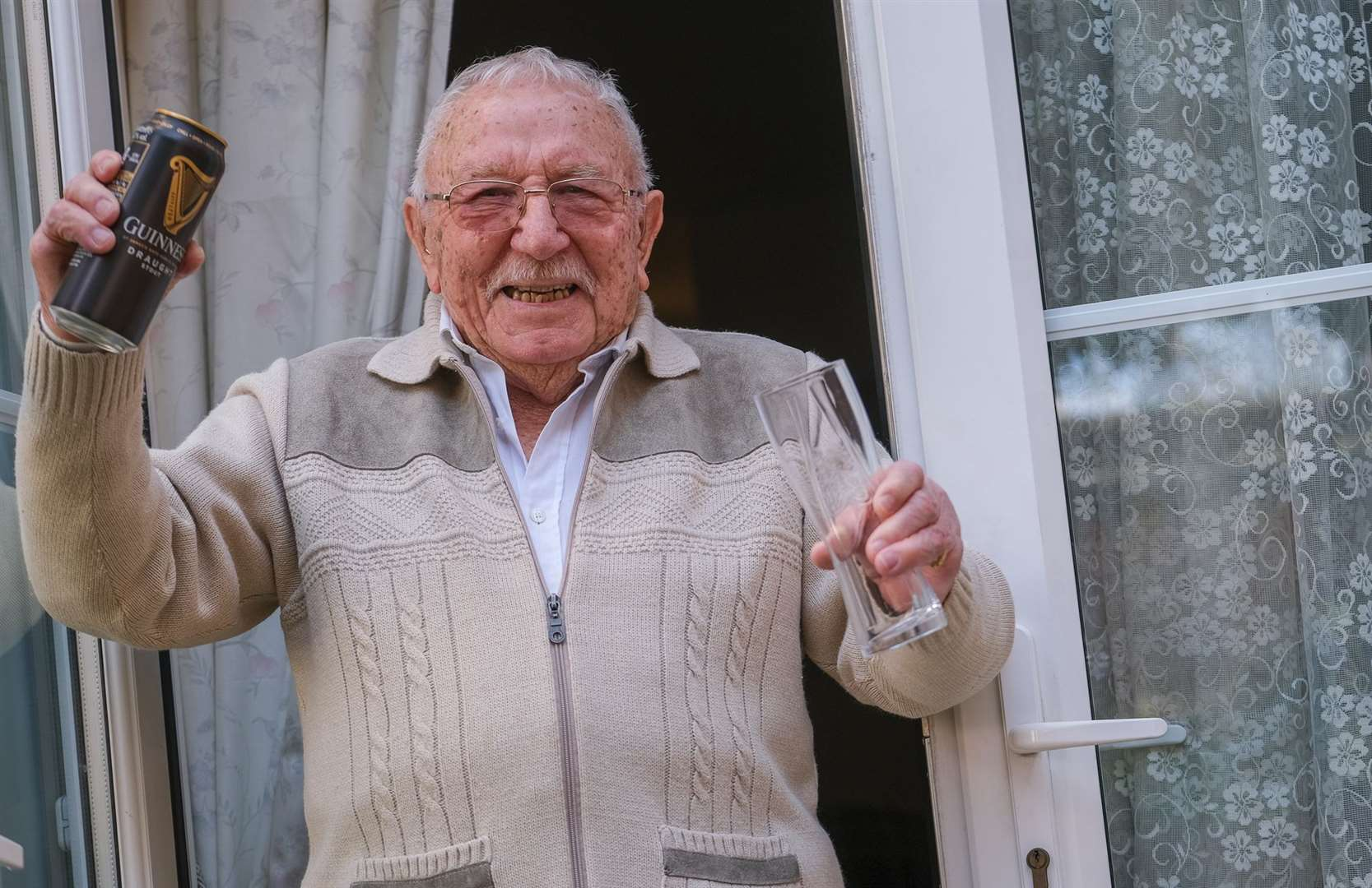 John Quince celebrates turning 100 years old - his secret to a long life is a Guinness a day. Picture Phil Cannings